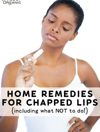 A woman holding chapstick as a home remedy for chapped lips.