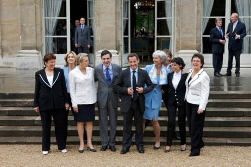 French President Nicolas Sarkozy and his PM Francois Fillon pose with the women ministers, 2007.