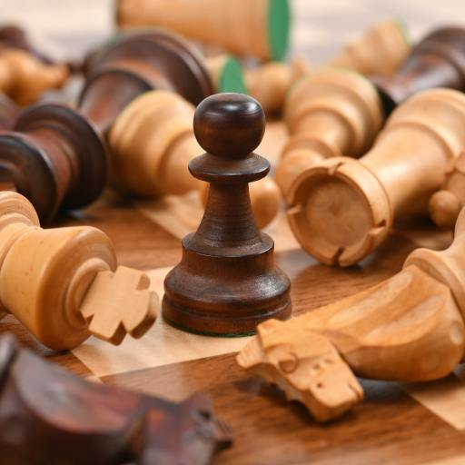 Chess pieces on a chess board, a metaphor for researching and defeating your competition in the App Store