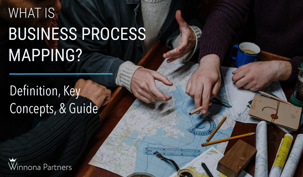 business process mapping blog cover guys working on a map