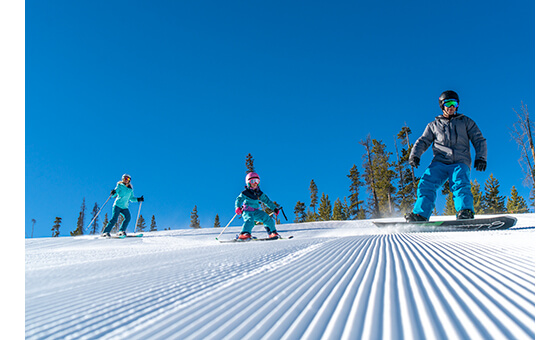 A family enjoys the corduroy on Cranmer, one of the most open runs at Winter Park
