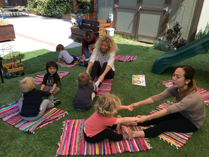 Partner yoga at Little Nest Learning Space