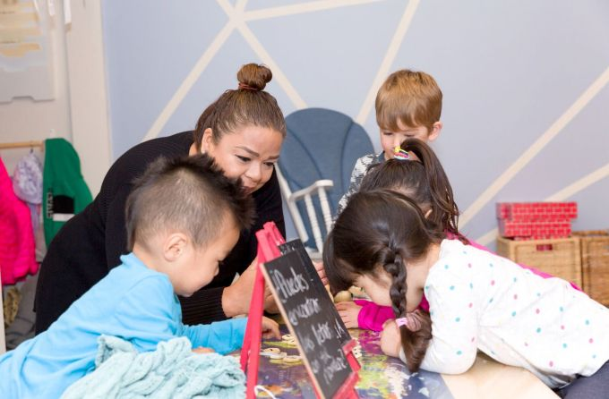 Children and director doing activities at an home preschool
