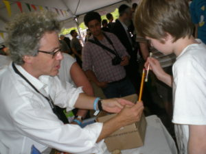 Allen helps a young scientist prepare to launch some potato.