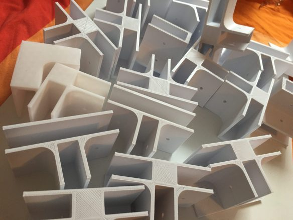 Pile of 3D printed shelfie brackets.