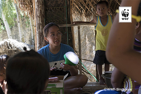Toni Munar, our adaptive technologies specialist from WWF-Philippines is showcasing the solar lamps to the local communities