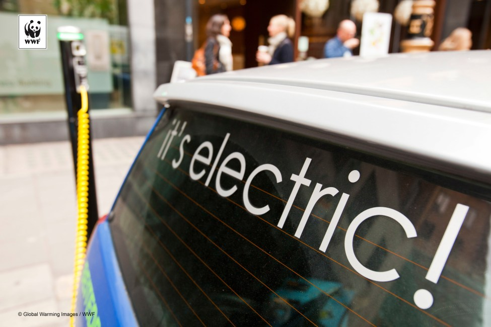 An electric vehicle at a recharging station on the street in Berkeley Square, London, UK.