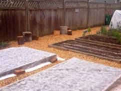 The Gr. 7 girls spread new bark mulch in the garden.