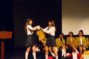Exchanging blazers with incoming Head Girl Saskia, at the Blazer Exchange Assembly.