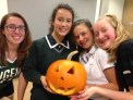 Tess (Gr. 10), Harriet, Adele (Gr. 10), and Georgia carving pumpkins at YHS (October 2017.