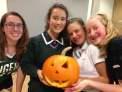 Tess (Gr. 10), Harriet, Adele (Gr. 10), and Georgia carving pumpkins at YHS (October 2017.
