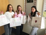 "Senior students holding ""Bags of Love"" ready to be donated to the YWCA's Crabtree Corner"