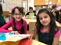 Little School students with their Grade 3 reading buddies