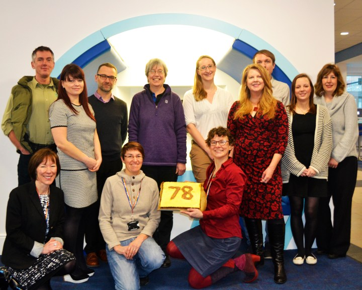 Staff across the University celebrate with a commemorative cake!