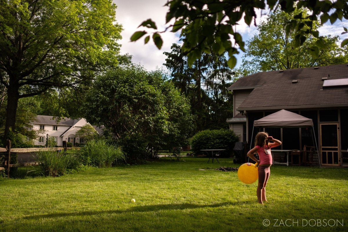 kids playing in backyard during the summer