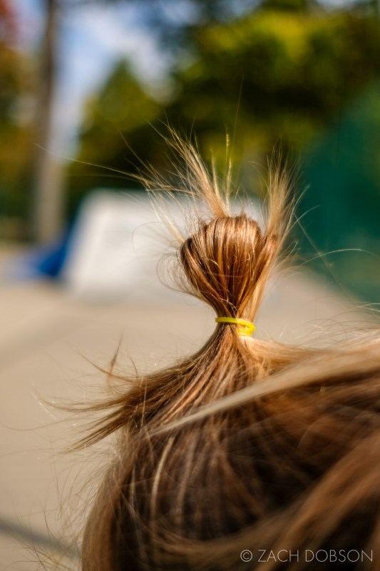 toddler's hair in a top-knot