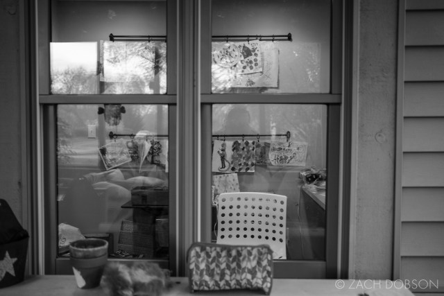 window into home office with reflections of outside