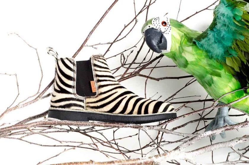 Botines de pelo Colour Feet con estampado de cebra.