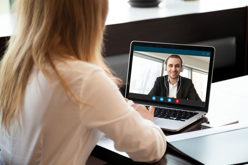 Business woman making video call to business partner via applica