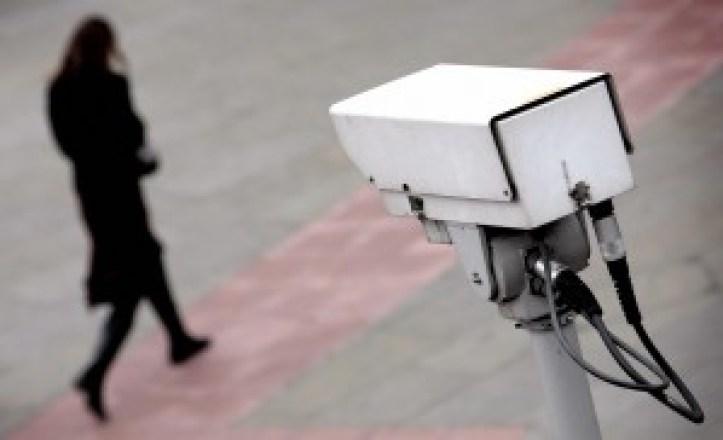 A police CCTV camera observes a woman wa
