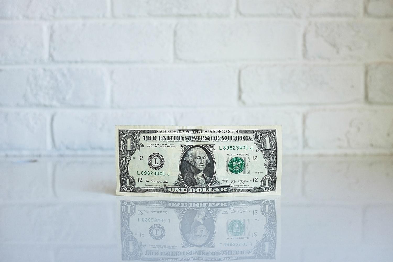 A dollar bill on the table