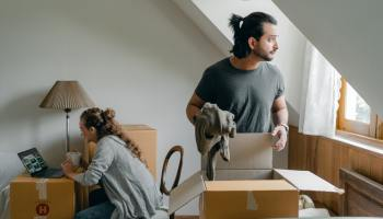 Two people moving in together into an apartment