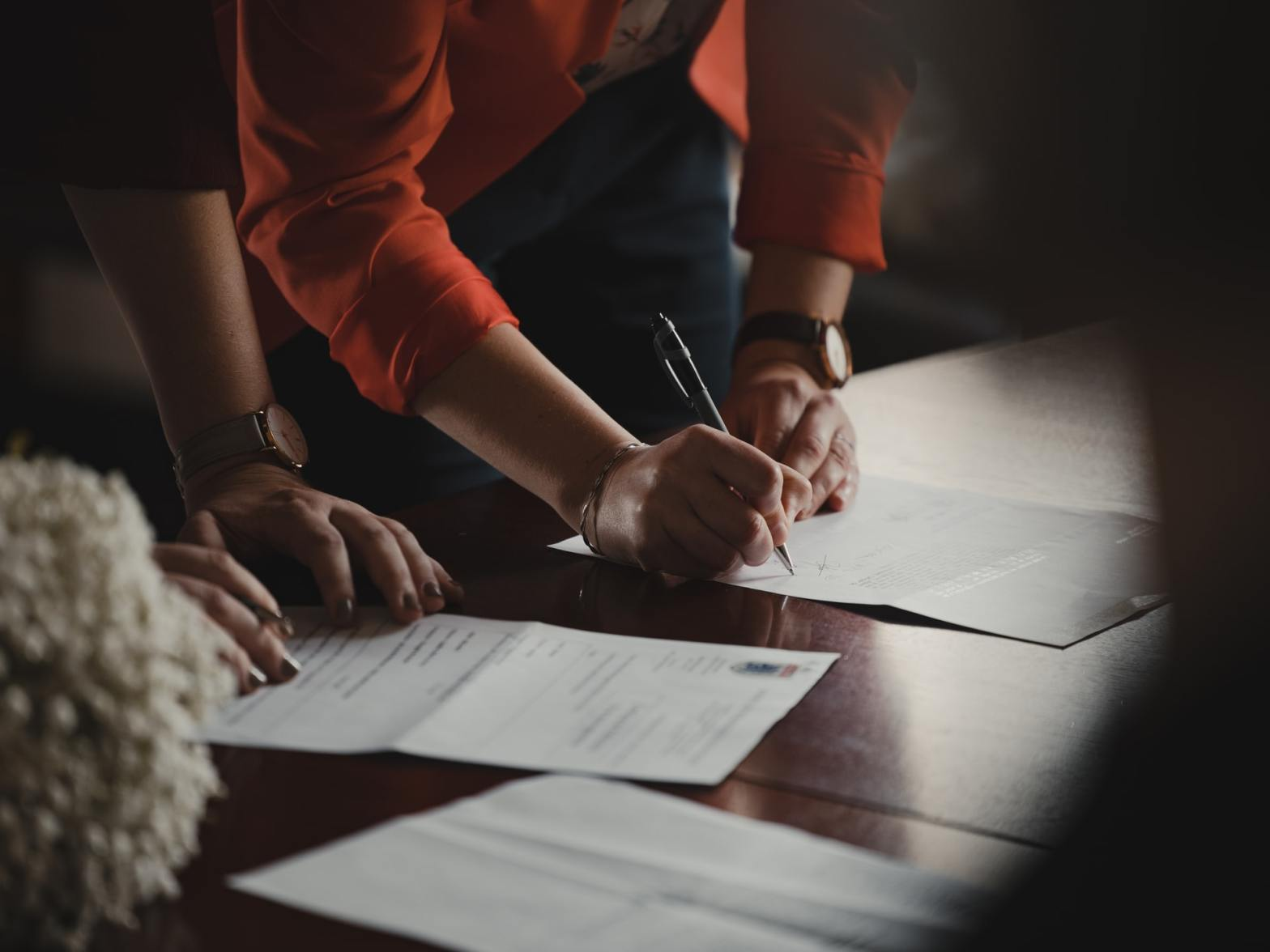 Two people signing an agreement