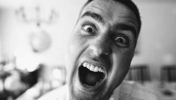 man screaming because of annoying roommate