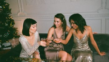 Three women enjoying cocktails at a Christmas Party