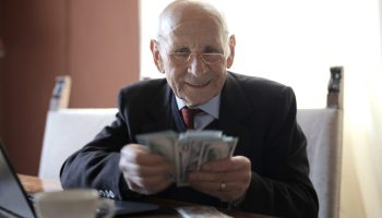 old man showing how to do personal finance management