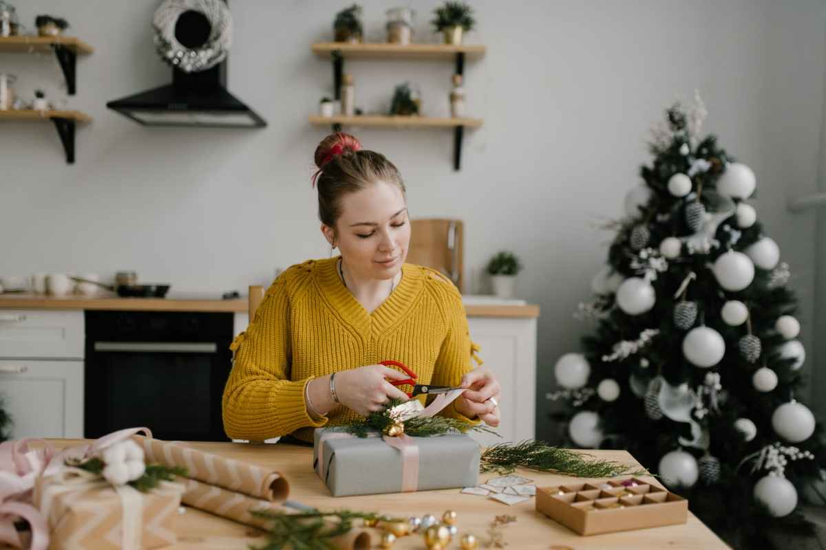 A woman wrapping christmas presents at home