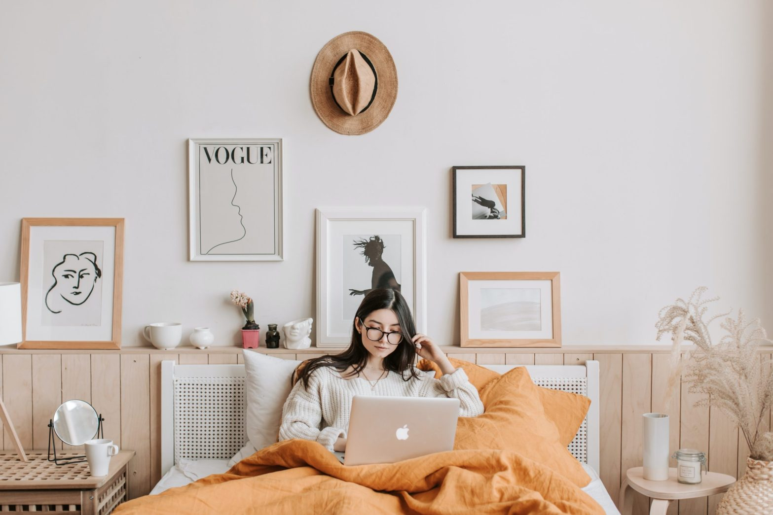 Girl sits in front of quirky cheap home decor