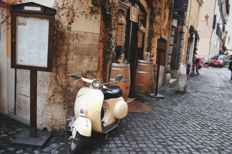 a vespa parked in Rome