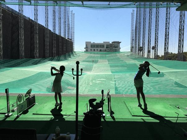 People golfing at Aroma resort