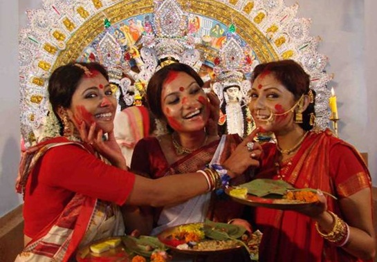 Image result for bengali women  durga puja doing aarti