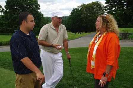 CEA Vice President and CEF President Sheila Cohen talks with Waterbury Teachers Association members Ray Byron and Kevin Egan.