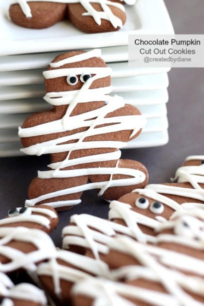 Chocolate-Pumpkin-Cut-Out-Cookies-decorated-like-Mummys-for-Halloween-@createdbydiane