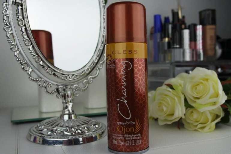 espelho refletindo tubo marron e dourado com escrito branco