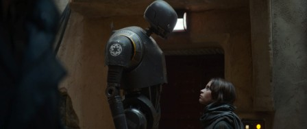 Rogue One: A Star Wars Story L to R: K-2SO (Alan Tudyk) and Jyn Erso (Felicity Jones) Ph: Film Frame ILM/Lucasfilm ©2016 Lucasfilm Ltd. All Rights Reserved.