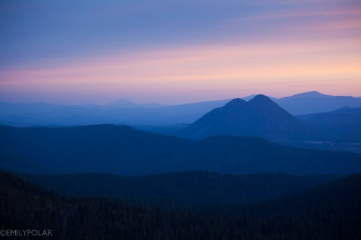 Black butte mountain and rolling hills of Mt. Shasta Wilderness at sunrise.