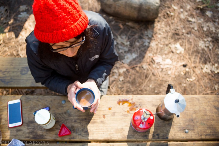 Woman making coffee with MSR stove in the morning at Upper Pines Campground in Yosemite.