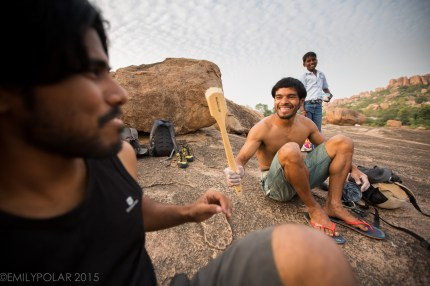 Men playing with big brush while taking a break from bouldering in Hampi, India.