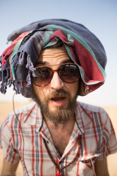 Hip Italian kid has fun with making scarf into a turban with cool shades in the Thar Desert.