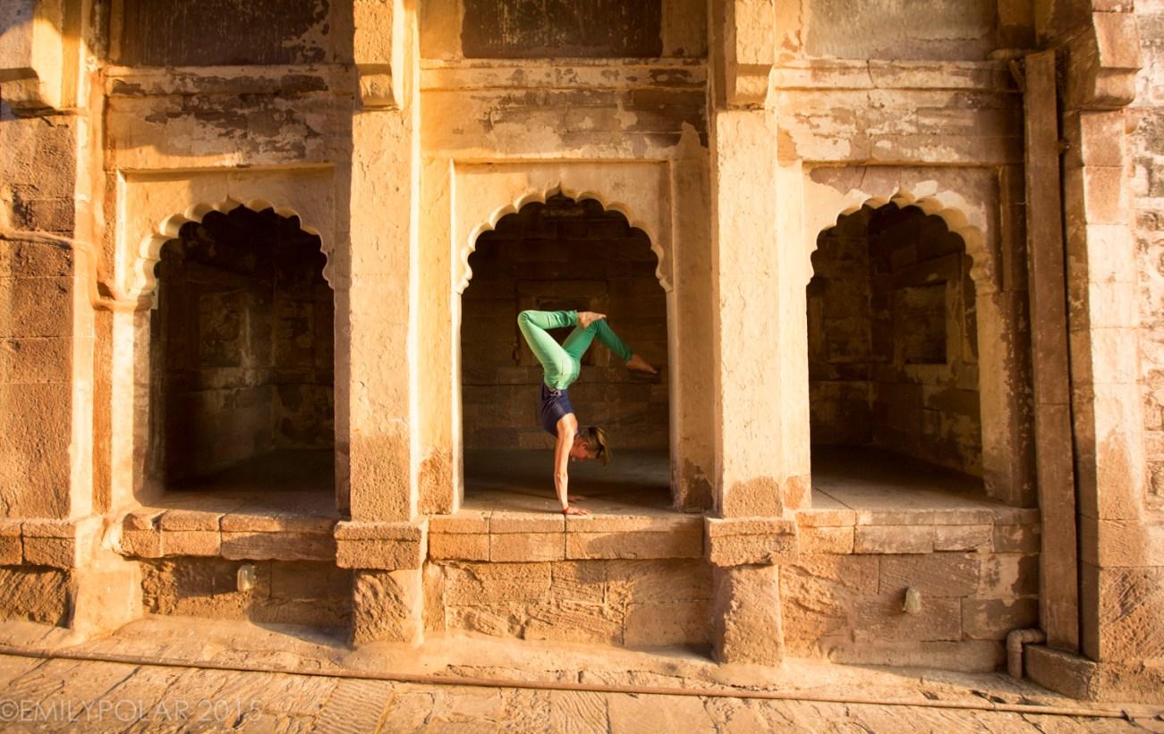 Woman doing handstands at Mehrangarh Fort in Jodhpur.