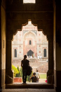 Woman posing for photo in beautiful arch silhouette at a Mosque in Lodi Gardens, Delhi.