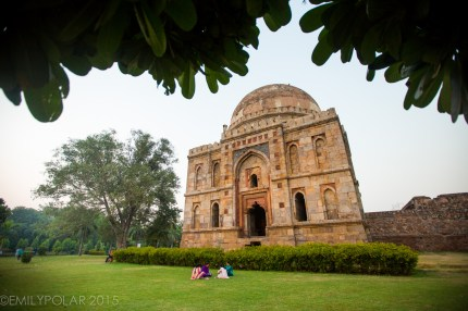 People hanging out Sheesh Gumbad at dusk in Lodi Gardens, Delhi.