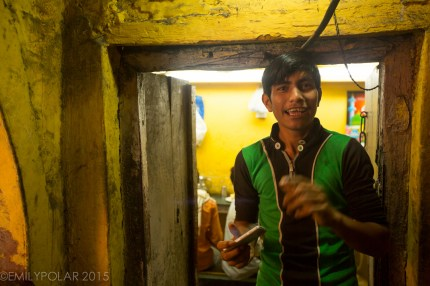 Young Indian boy taking a picture of me with his smart phone in Old Delhi, India.