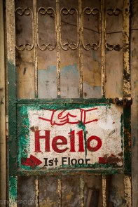 Hello sign at metal gate of an entrance to a shop in the streets of Chawri Bazar, Old Delhi.