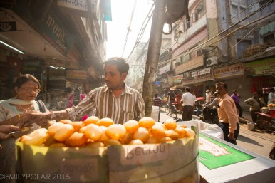 Indian man selling Pani Puri working as a street food vendor in Old Delhi, India.