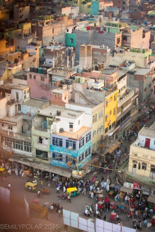 Aerial view from the Jama Masjid Tower of Old Delhi busy streets filled with people in crowded urban spaces of India.